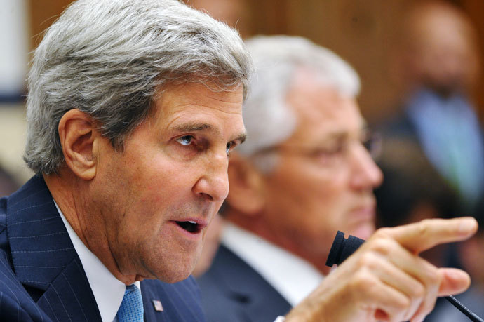 US Secretary of State John Kerry (L) speaks as US Defense Secretary Chuck Hagel (R) watches while testifying on Syria to the House Armed Services Committee on September 10, 2013 in the Rayburn House Office Building on Capitol Hill in Washington, DC.(AFP Photo / Mandel Ngan)