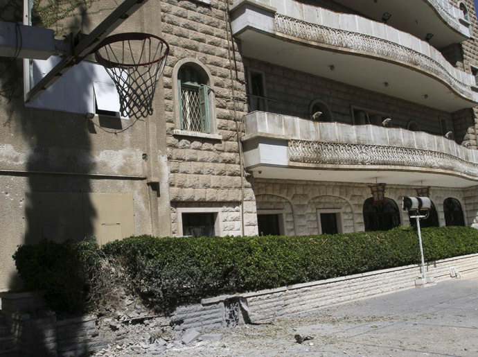 Damage is pictured inside the courtyard of the China embassy after a mortar shell hit the building, in Damascus September 30, 2013. (Reuters)
