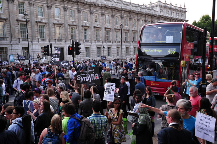 Protesters block Whitehall during a demonstration against British military involvement in Syria opposite Downing Street in central London on August 28, 2013. (AFP Photo/Carl Court)
