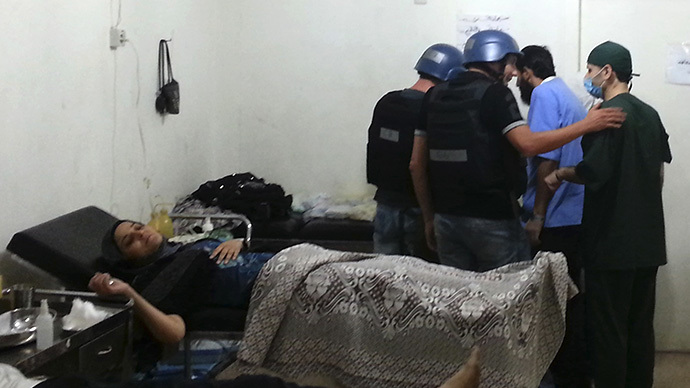 U.N. chemical weapons experts visit a hospital where wounded people affected by an apparent gas attack are being treated, in the southwestern Damascus suburb of Mouadamiya, August 26, 2013. (Reuters)