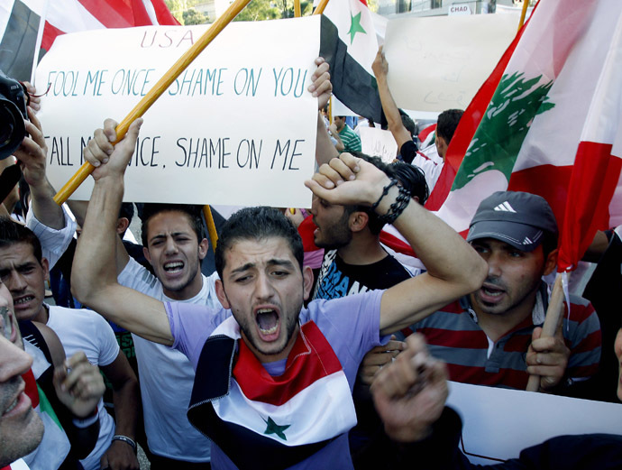 Lebanese supporters of Syrian regime, shout slogans during a demonstration near the US embassy, east of Beirut against a possible US military strike on Syria on September 7, 2013. (AFP Photo)