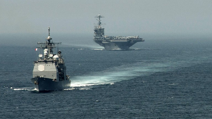 (FILE PHOTO) The guided-missile cruiser USS Gettysburg (CG 64) (L) and the aircraft carrier USS Harry S. Truman (CVN 75) transiting the Strait of Gibraltar on their way to the Mediterranean Sea. (AFP Photo / Jamie Cosby)