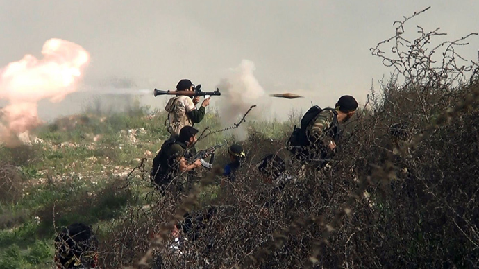An image grab taken from a video shows an opposition fighter firing an rocket propelled grenade (RPG) on August 26, 2013 (AFP Photo / Salah Al-Ashkar)
