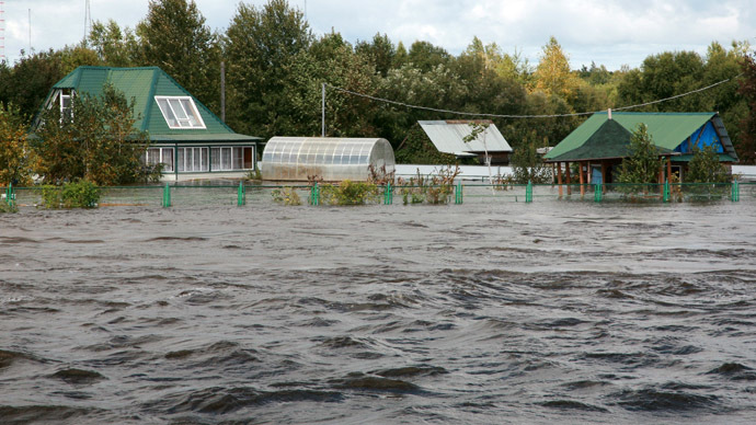 Flooded houses in the village of Vladimirovka outside Khabarovsk. (RIA Novosti/Vyacheslav Reutov)