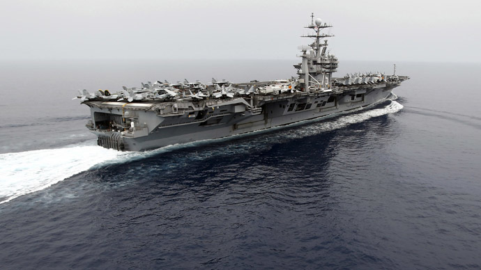 The nuclear-powered aircraft carrier USS Harry S. Truman is seen at an undisclosed position in the Mediterranean Sea (Reuters/Fabrizio Bensch)