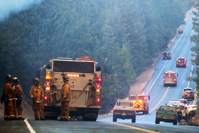 Fire crews line up along Highway 120 at the Rim Fire in this undated United States Forest Service handout photo near Yosemite National Park, California, released to Reuters August 27, 2013. (Reuters/Mike McMillan/U.S. Forest Service/Handout via Reuters)