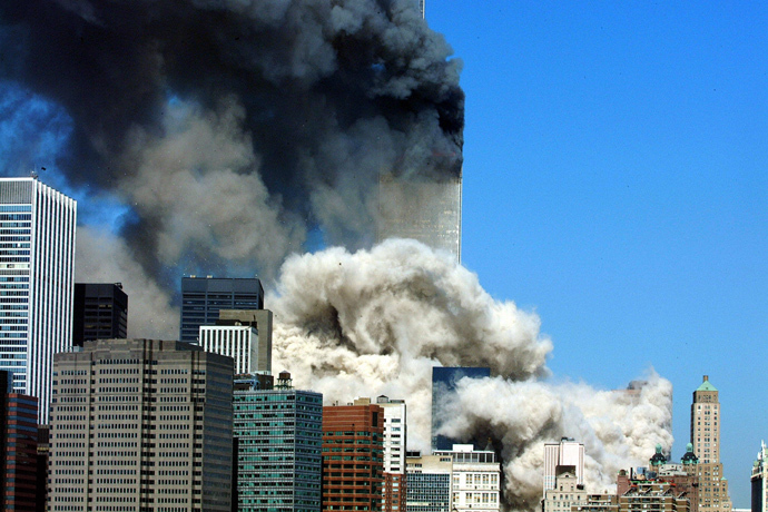 This 11 September, 2001 file photo shows smoke billowing up after the first of the two towers of the World Trade Center collapses in New York City (AFP Photo / Files / Henny Ray Abrams)
