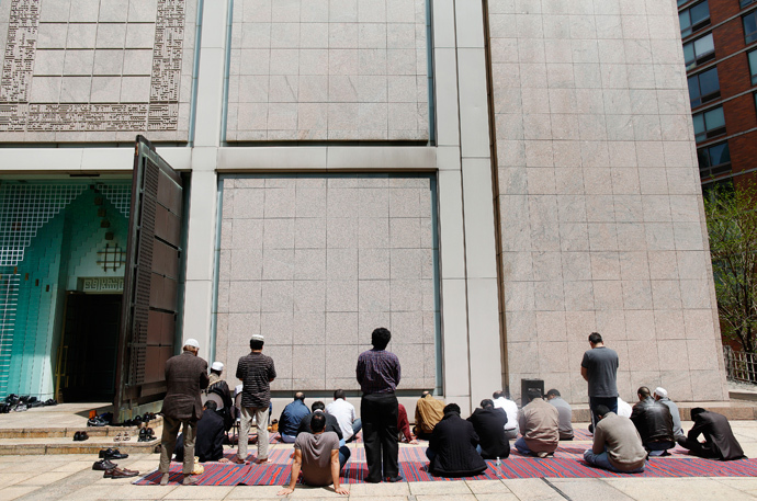 Muslim men pray outside the Islamic Center of New York (Reuters / Shannon Stapleton)
