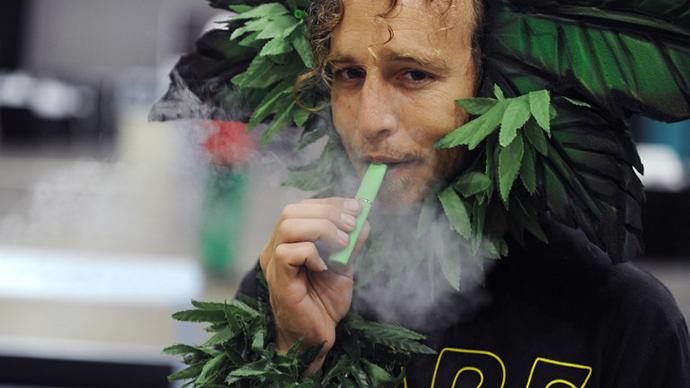 A man calling himself Henry Hemp inhales marijuana using a vaporizer pen at HempCon medical marijuana show at the Los Angeles Convention Center. (AFP Photo / Robyn Beck)