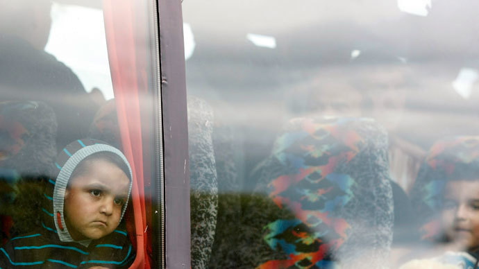 Romanians leave the Ozone Leisure Centre to spend the night in sheltered accommodation, Belfast.(Reuters / Cathal McNaughton)
