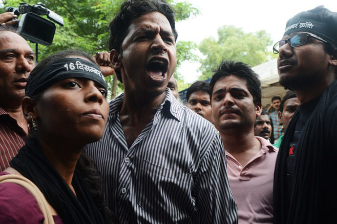 Indian activists shout as they demand the death of a juvenile, convicted in the December 2012 gang-rape of a student, in front of a juvenile court in New Delhi on August 31, 2013. (AFP Photo / Raveendran)