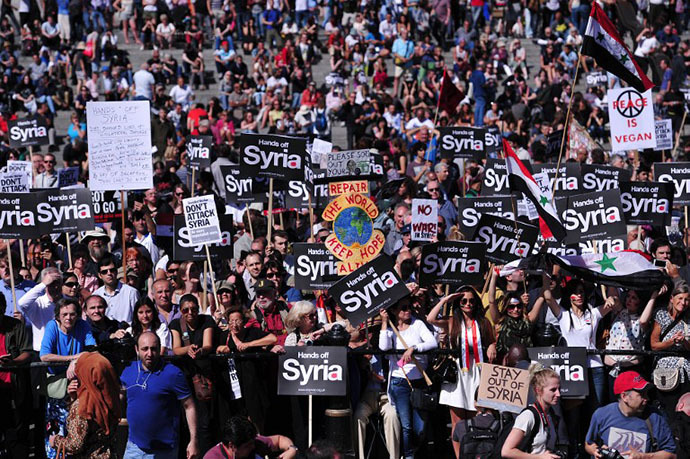 Hundreds of people take part in a protest against military intervention in Syria in central London on August 31, 2013. (AFP Photo / Carl Court)