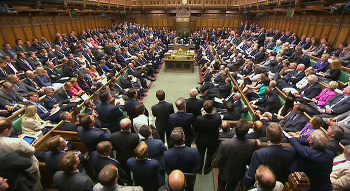 Members of Parliament are seen attending a session of Parliament in the House of Commons in London (Reuters / UK Parliament via Reuters TV)