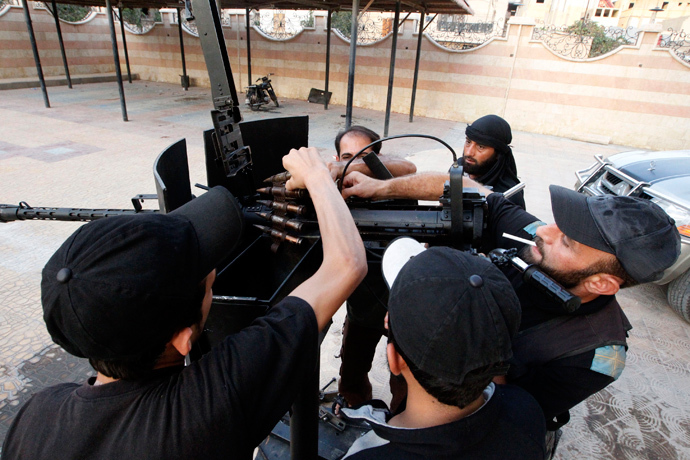 Free Syrian Army fighters clean and inspect their weapon in Raqqa province, eastern Syria September 1, 2013 (Reuters / Nour Fourat)