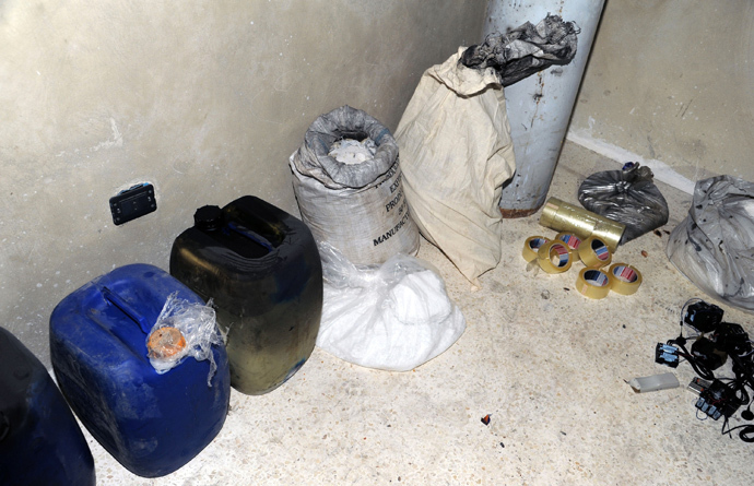 A handout picture released by the Syrian Arab News Agency (SANA) on August 24, 2013 shows bags and containers of what the Syrian government claims to be materials used to make chemical weapons discovered in Jobar on the outskirts of the capital Damascus (AFP Photo / HO / SANA)