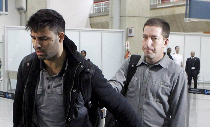 A picture dated August 19, 2013 shows David Miranda (L) -- the Brazilian partner of Glenn Greenwald, a US journalist with Britain's Guardian newspaper who worked with intelligence leaker Edward Snowden to expose US mass surveillance programmes -- is pictured at Rio de Janeiro's Tom Jobim international airport upon his arrival. (AFP Photo / Marcelo Piu)