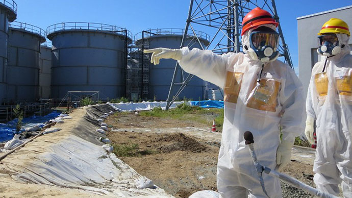 Japanese Economy, Trade and Industry Minister Toshimitsu Motegi inspecting contamination water tanks at TEPCO's Fukushima Dai-ichi nuclear power plant in the town of Okuma, Fukushima prefecture. (AFP Photo)