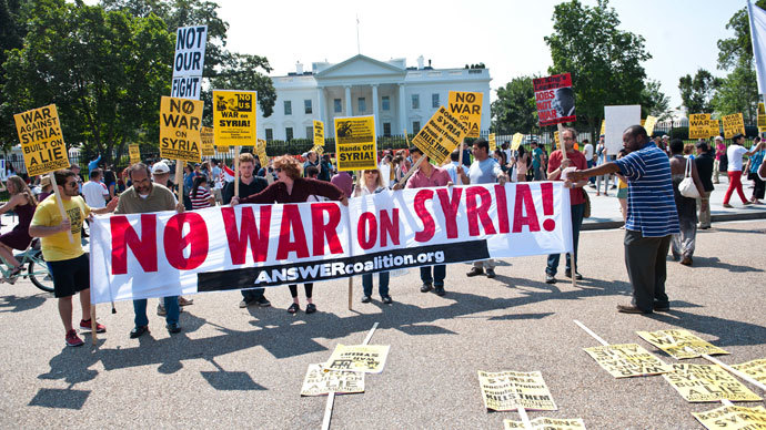 People demonstrate against a US-led strike on Syria in front of the White House in Washington on August 31, 2013.(AFP Photo / Nicholas Kamm)
