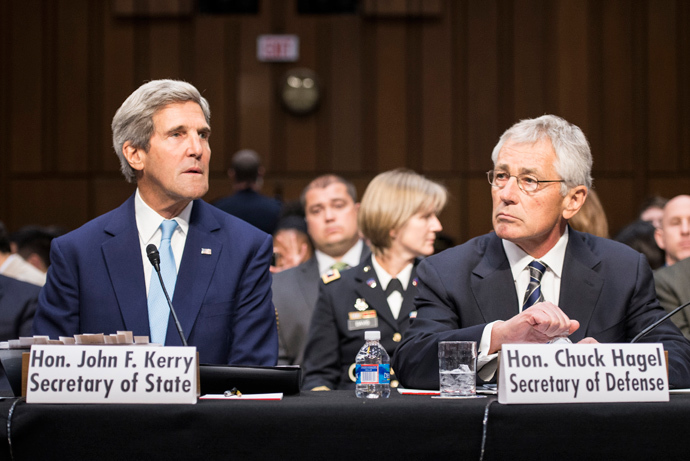 US Secretary of State John Kerry and US Secretary of Defense Chuck Hagel listen during a hearing of the Senate Foreign Relations Committee on Capitol Hill September 3, 2013 in Washington, DC (AFP Photo / Brendan Smialowski)
