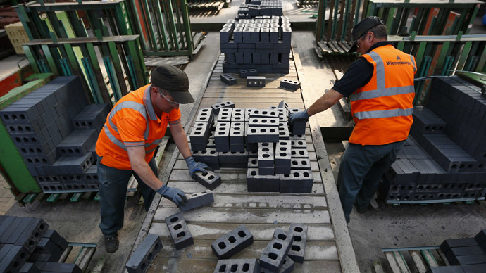 Workers pack bricks at the Wienerberger Brick Factory in Dosthill, central England August 8, 2013. (Reuters/Darren Staples)