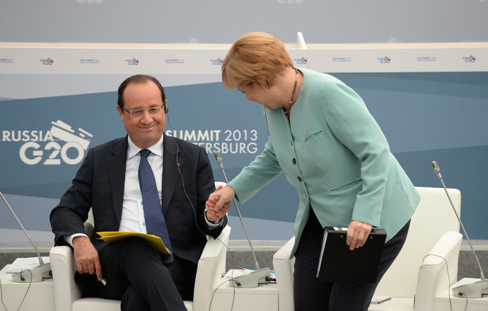 French President Francois Hollande and German Chancellor Angela Merkel attend a meeting with business leaders in St.Petersburg September 6, 2013 (Reuters / Alexei Filippov)