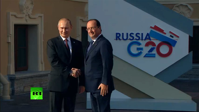 Putin greets Hollande.
