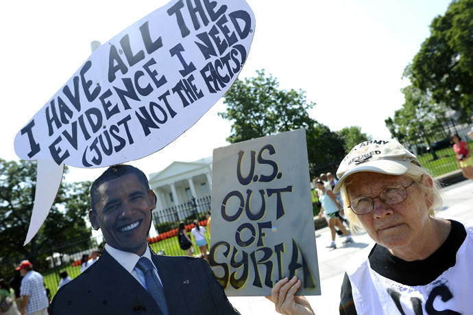 Anti-war demonstrators protest in front of the White House in Washington, DC, on September 2, 2013, against a possible US attack on Syria in response to possible use of chemical weapons by the Assad government. (AFP Photo/Jewel Samad)