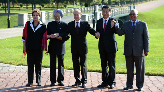 President of the Federative Republic of Brazil Dilma Vana Rousseff, Prime Minister of the Republic of India Manmohan Singh, second left, President of the Russian Federation Vladimir Putin, President of the People's Republic of China Xi Jinping and President of the Republic of South Africa Jacob Zuma, from left, pose for group photographs.(RIA Novosti / Alexey Maishev)