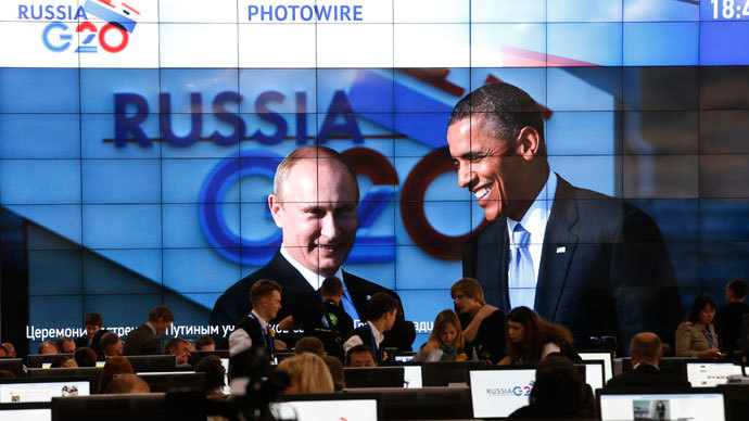 Russian President Vladimir Putin (L) and U.S. President Barack Obama are pictured on a video screen installed in the press centre of the G20 Summit in Strelna near St. Petersburg, September 5, 2013.(Reuters / Grigory Dukor)