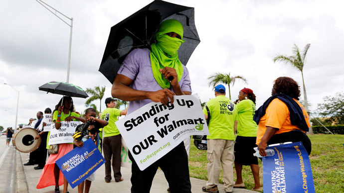 Walmart workers and supporters protest low wages outside one of the company's stores in Miami Gardens, Florida September 5, 2013.(Reuters / Joe Skipper)