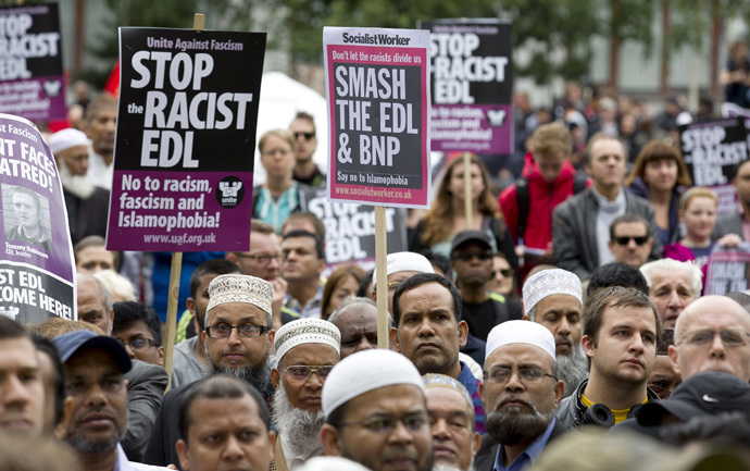 Members of Unite Against Fascism (UAF) and local people gather in a park in Tower Hamlets ahead of a demonstration by the right-wing EDL (English Defence League) in London, on September 7, 2013. (AFP Photo/Justin Tallis)