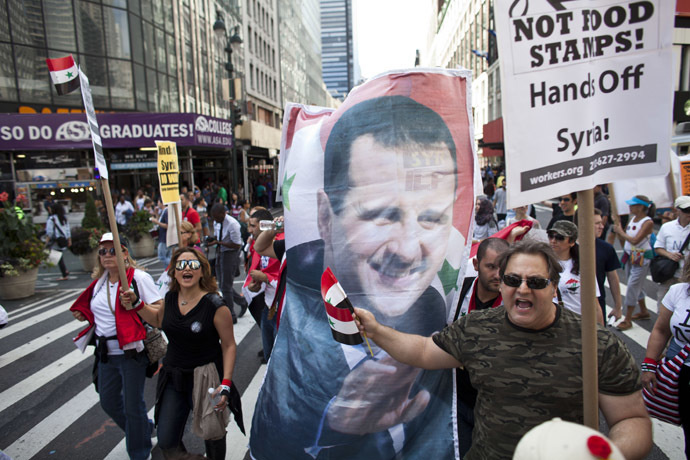 Demonstrators march after a rally on Times Square September 7, 2013 in New York City. (Ramin Talaie/Getty Images/AFP)