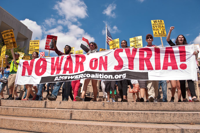 People march from the White House to the US Capitol in Washington against US intervention in Syria on September 7, 2013. (AFP Photo/Nicholas Kamm)