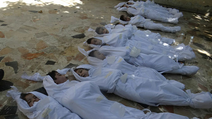bodies of children wrapped in shrouds as Syrian rebels claim they were killed in a toxic gas attack by pro-government forces in eastern Ghouta, on the outskirts of Damascus on August 21, 2013.(AFP Photo / Shaam News Network)