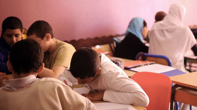 Pupils attend a lesson in a classroom on May 11, 2011 at the Alif private muslim school in the French southwestern city of Toulouse.(AFP Photo / Eric Cabanis)