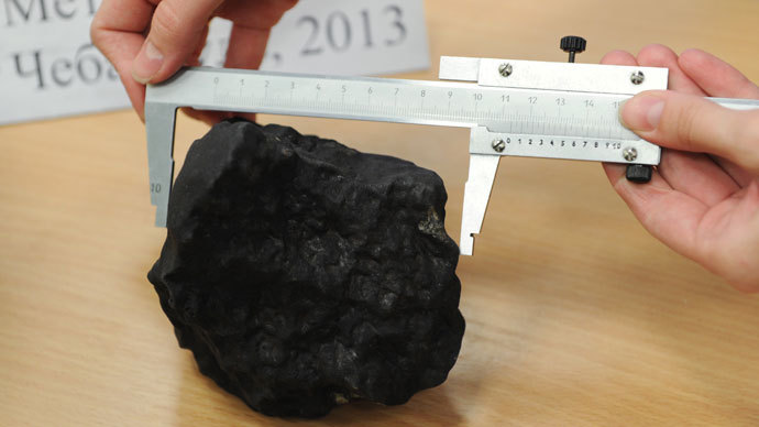 Fragment of the meteorite at the laboratory of the Research and Educational Center of Nanomaterials and Nanotechnologies of Ural Federal University.(RIA Novosti / Pavel Lisitsyn)