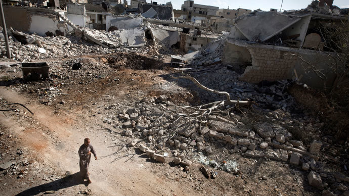A man walks through a destroyed residential area of the Syrian city of Saraqib, southwest of Aleppo, on September 9, 2013.(AFP Photo / Giovanni Diffidenti)