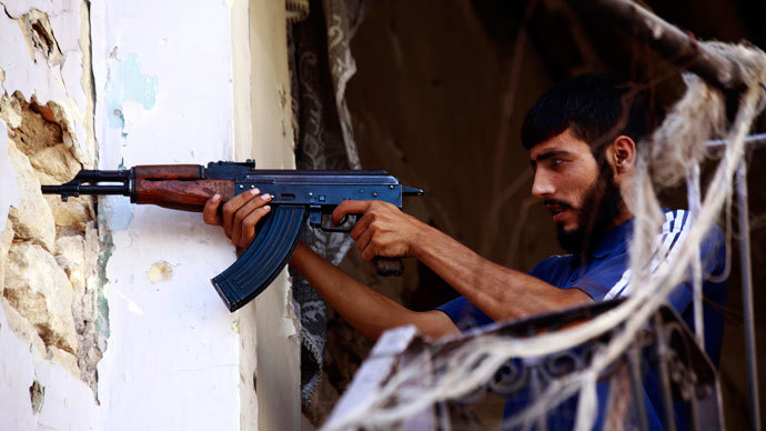 A Free Syrian Army fighter takes up a shooting position in Ogiwl, Aleppo, September 8, 2013.(Reuters / Hamid Khatib)
