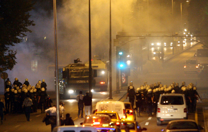 Riot police use teargas and water cannon to disperse protesters during clashes September 10, 2013 in Ankara following the death of a 22-year-old demonstrator in southern Turkey (AFP Photo / Adem Altan)