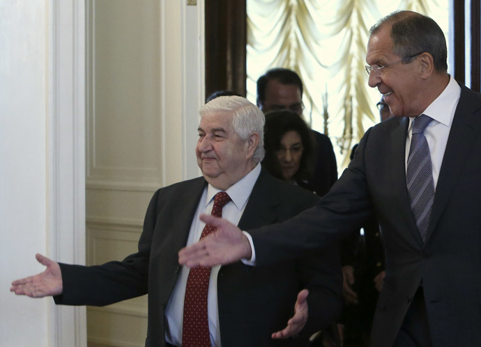 Russia's Foreign Minister Sergei Lavrov (R) shows the way to his Syrian counterpart Walid Moualem during a meeting in Moscow September 9, 2013. (Reuters/Sergei Karpukhin)