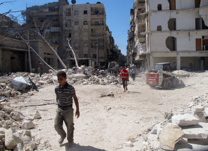 Men walk on rubble of buildings damaged by what activists said was shelling by forces loyal to Syria's President Bashar al-Assad in Aleppo's Bustan al-Qasr district, September 9, 2013.(Reuters / Abdalghne Karoof)