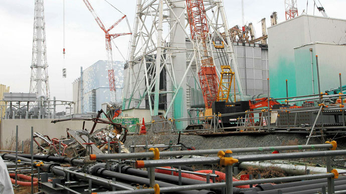 A general view shows unit three and unit two reactor building (light blue, L) of the Tokyo Electric Power Co (TEPCO) Fukushima Dai-Ichi nuclear power plant stands in Okuma Town, in Fukushima prefecture on March 1, 2013.(AFP Photo / Jiji Press)