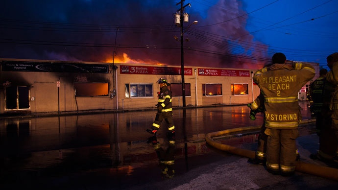 New Jersey firefighters walk near a massive fire as they work to control it in Seaside Park in New Jersey September 12, 2013.(Reuters / Eduardo Munoz)