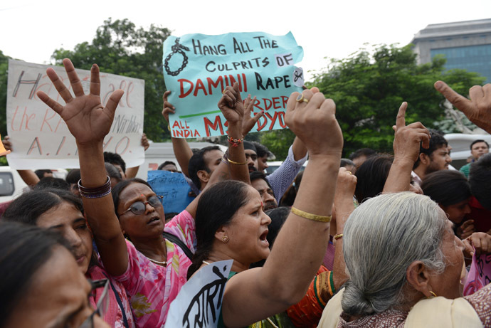 Indian women shout slogans outside the District court in Saket as they call for the death penalty the four men convicted of rape and murder in New Delhi on September 13, 2013. (AFP Photo/Roberto Schmidt)