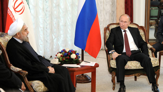 Russia's President Vladimir Putin speaks with his Iranian counterpart Hassan Rowhani as they meet on the sidelines of a summit of the Shanghai Cooperation Organization (SCO) in the Kyrgyzstan's capital Bishkek, on September 13, 2013.(AFP Photo / Mikhail Klimentyev)