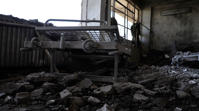 A view shows damaged medical beds at Raqqa national hospital, hit by what activists said was a Syrian Air Force fighter jet loyal to President Bashar al-Assad in Raqqa province, eastern Syria June 20, 2013.(Reuters / Nour Fourat)