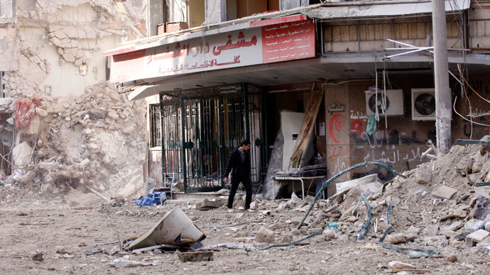 A civilian inspects the damage in front of the Dar Al Shifa hospital after shelling in Aleppo.(Reuters / Zain Karam)