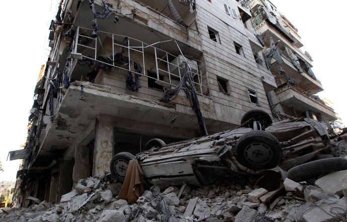 A damaged car is seen on the rubble of a damaged building in the Aleppo district of Salaheddine September 13, 2013.(Reuters / Muzaffar Salman)