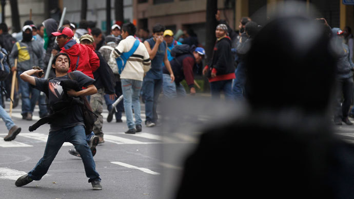 A protester throws stone as striking members of the teachers' union CNTE are evicted from Zocalo Square in downtown Mexico City September 13, 2013.(Reuters / Edgard Garrido)
