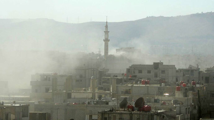 Smoke above buildings following what Syrian rebels claim to be a toxic gas attack by pro-government forces in eastern Ghouta, on the outskirts of Damascus on August 21, 2013.(AFP Photo / Shaam News Network )